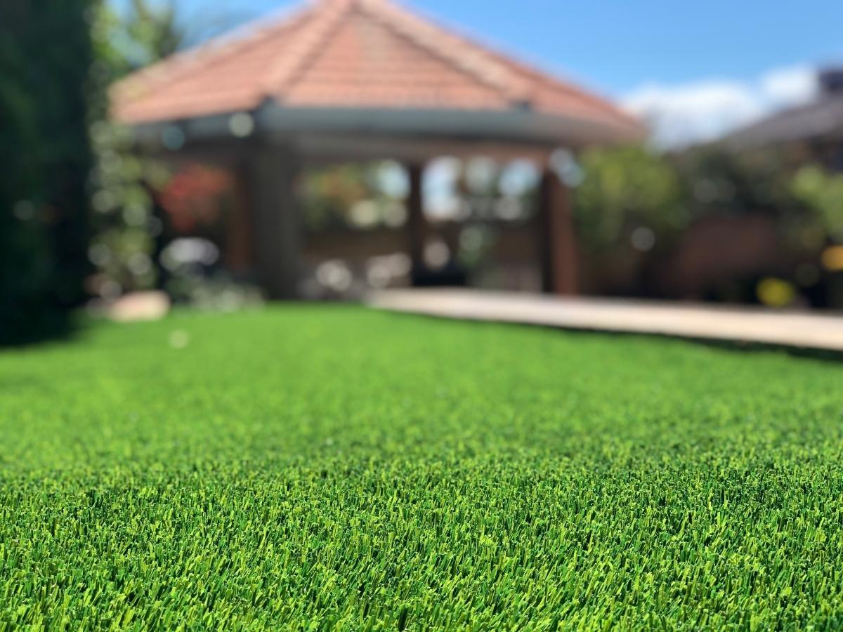 Synthetic Lawn Installation Backyard