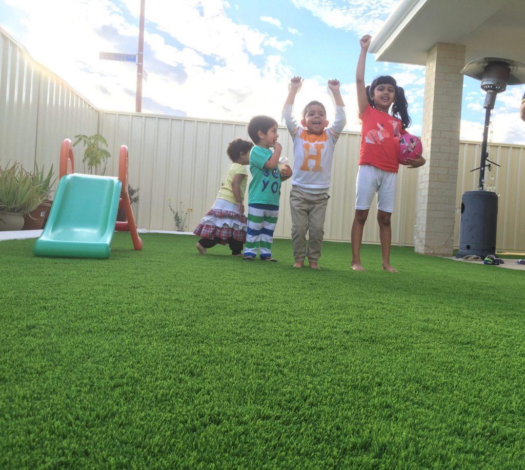 Kids Playing On Artificial grass Perth Backyard